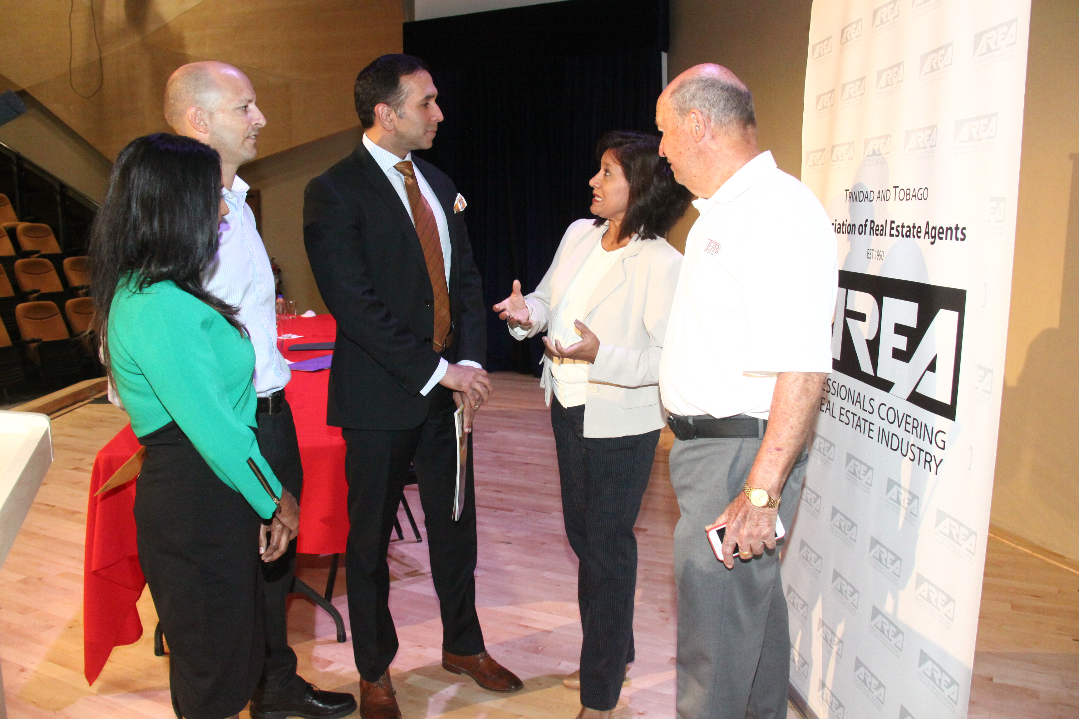 (left to right) AREA President, Sally Singh chat with Jean-Paul de Meillac of Terra Caribbean Trinidad, the Hon. Attorney General Mr. Faris Al-Rawi, Jo-Ann Traboulay and Jean de Meillac of Terra Caribbean